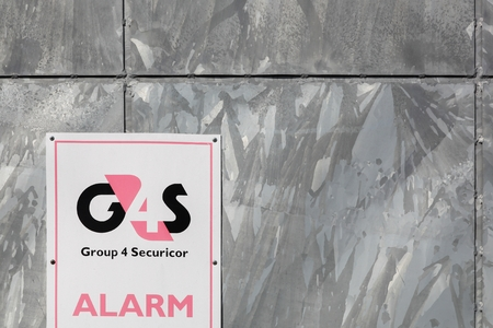 security company: Tilst, Denmark - May 16, 2016: G4S logo on a wall. G4S is a British multinational security services company headquartered in central London and It is the worlds largest security company