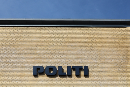 legitimate: Horsens, Denmark - May 22, 2016: Danish police sign on a wall. The police of Denmark called politi in danish is the interior part of the Danish legitimate force providers