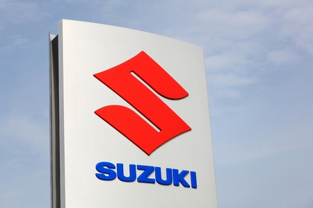 specializes: Haderslev, Denmark - May 29, 2016: Suzuki logo on a panel. Suzuki is a Japanese multinational corporation which specializes in manufacturing automobiles, four-wheel drive vehicles and motorcycles
