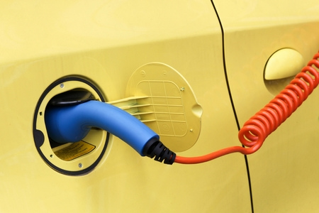 electric motor: Electric car in charging station