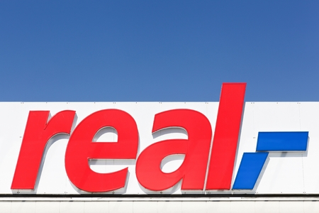 hypermarket: Flensburg, Germany - June 4, 2016:  Real sign on a facade. Real is a European hypermarket, member of the German trade and retail giant Metro AG Editorial