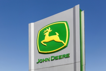 john deere: Flensburg, Germany - June 4, 2016:  John Deere sign on a panel. John Deere is an American corporation that manufactures agricultural, construction, and forestry machinery, diesel engines Editorial