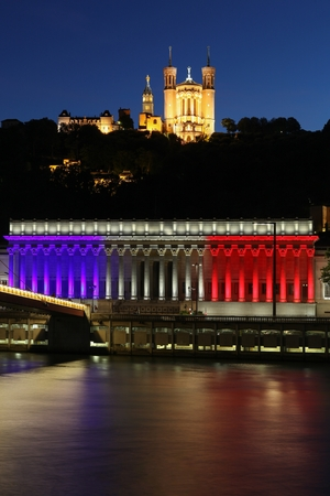 tribute: Lyon, France - July 15, 2016: French national colors on the courthouse in Lyon called palais de justice in French in tribute to all victims of terror in Nice, France Editorial