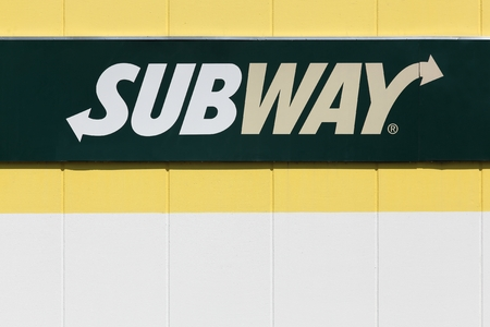primarily: Lozanne, France - July 7, 2016: Subway logo on a facade. Subway is an American fast food restaurant franchise that primarily sells submarine sandwiches and salads