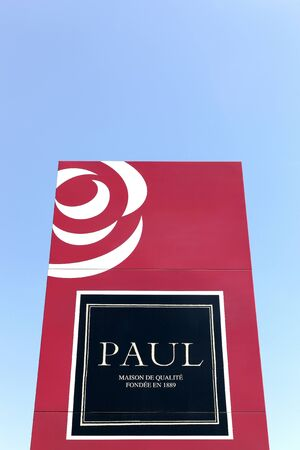 specializes: Masseret, France - June 23, 2016: Paul logo on a wall. Paul is a French chain of bakery café restaurants established in 1889 in France. It specializes in serving French products including breads, sandwiches, macarons, cakes, pastries Editorial