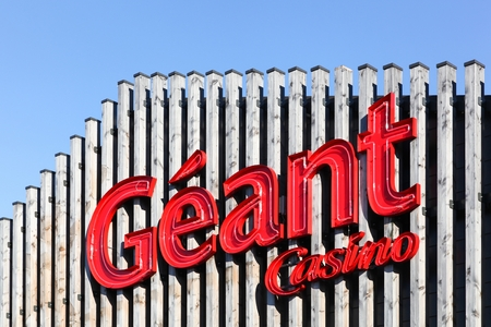 hypermarket: Villefranche sur Saone, France - July 15, 2016: Geant Casino logo on a facade. Geant Casino is a hypermarket chain based in Saint Etienne, France