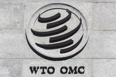 Geneva, Switzerland - August 14, 2016: The World Trade Organization sign on a wall. The World Trade Organization also called WTO is an intergovernmental organization which regulates international trade Banco de Imagens - 61496972