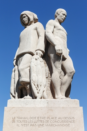 The Four Races statue represents workers from different trades and continents in Geneva, Switzerland