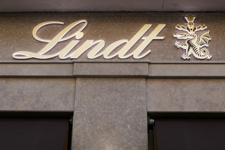 lindt: Lyon, France - August 15, 2016:  Lindt logo on a wall. Lindt is a Swiss chocolatier and confectionery company