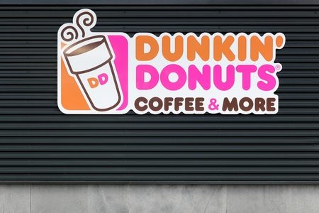 Wasserbillig, Luxembourg - July 24, 2016: Dunkin Donuts sign on a wall. Dunkin Donuts is an American global doughnut company and coffeehouse chain
