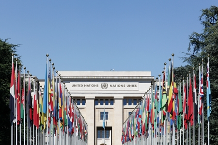 international flags: Geneva, Switzerland - August 14, 2016: Palace of United Nations in Geneva, Switzerland. It has served as the home of the United Nations Office at Geneva since 1946 Editorial