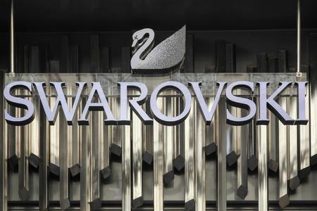 swarovski: Lyon, France - August 15, 2016:  Swarovski logo on a wall. Swarovski is an Austrian producer of luxury cut lead glass, headquartered in Wattens, Austria Editorial