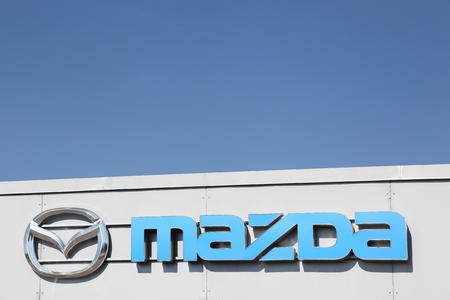 mazda: Fredericia, Denmark - September 10, 2016: Mazda logo on dealer facade. Mazda is a Japanese automaker based in Fuchu, Japan