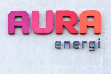 electricity company: Viby, Denmark - September 11, 2016: Aura Energi logo on a wall. Aura Energi provides electricity, energy, fiber, televisions and home appliances in Denmark