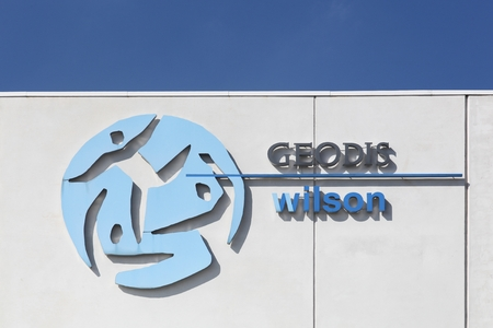wilson: Vejle, Denmark - September 10, 2016:  Geodis Wilson logo on a wall.  Geodis is the division of the SNCF group responsible for freight transportation and logistics