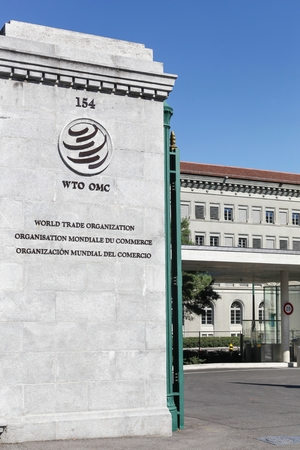 Geneva, Switzerland - August 14, 2016: The World Trade Organization entrance. The World Trade Organization is an intergovernmental organization which regulates international trade in Geneva