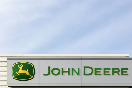 deere: Trige, Denmark - September 22, 2016:  John Deere sign on a wall. John Deere is an American corporation that manufactures agricultural, construction, and forestry machinery, diesel engines
