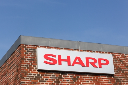 Aarhus, Denmark - September 25, 2016: Sharp logo on a wall. Sharp is a Japanese multinational corporation that designs and manufactures electronic products