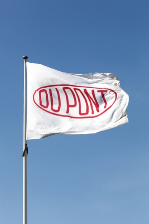 Aarhus, Denmark - May 16, 2016: Flag of the brand Du Pont. DuPont is one of Americas most innovative companies and it is an American chemical company that was founded in July 1802 as a gunpowder mill