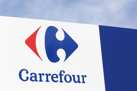 carrefour: Macon, France - October 10, 2016: Carrefour sign on a panel. Carrefour is a french multinational retailer headquartered in France and it is one of the largest hypermarket chains in the world