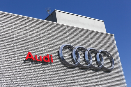 Lyon, France - July 3, 2016: Audi logo on a wall. Audi is a German automobile manufacturer that designs, engineers, produces, markets and distributes luxury vehicles