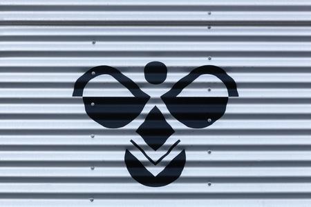 Aarhus, Denmark - November 12, 2016: Hummel logo on a wall. Hummel International is a sportswear company based in Denmark