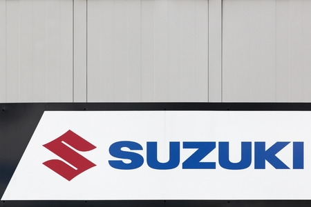 specializes: Macon, France - October 10, 2016: Suzuki logo on a wall. Suzuki is a Japanese multinational corporation which specializes in manufacturing automobiles, four-wheel drive vehicles and motorcycles Editorial