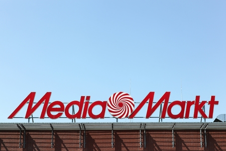 building a chain: Kiel, Germany - June 4, 2016: Media Markt logo on a building. Media Markt is a German chain of stores selling consumer electronics with numerous branches throughout Europe and Asia