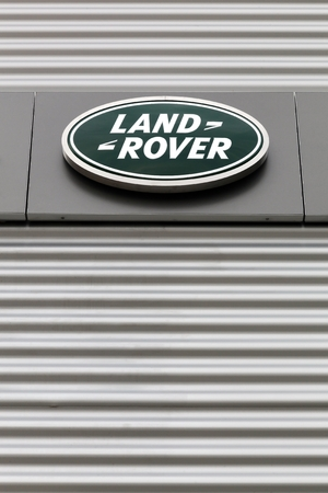 fourwheeldrive: Kolding, Denmark - May 29, 2016: Land Rover logo on a wall. Land Rover is a car brand that specialises in four-wheel-drive vehicles, owned by British multinational car manufacturer Jaguar Land Rover