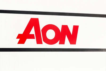 brokerage: Aarhus, Denmark - November 12, 2016: Aon logo on a wall. Aon is a British multinational corporation that provides risk management, insurance, reinsurance brokerage, investment banking and human resource solutions