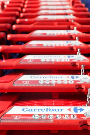Macon, France - October 30, 2016: Carrefour shopping carts. Carrefour is a french multinational retailer headquartered in France and it is one of the largest hypermarket chains in the world