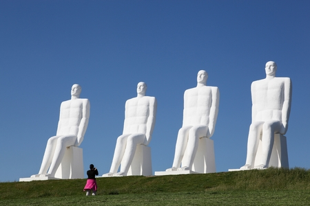 Esbjerg, Denmark - June 11, 2015: The sculpture Men at sea in Esbjerg, Denmark. The 4 men looking at the sea are made in white concrete by the danish artist Svend Wiig Hansen Editorial
