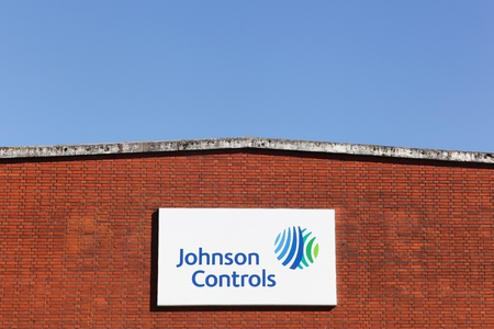 Holme, Denmark - March 26, 2017: Johnson controls logo on a wall. Johnson Controls is an America multinational conglomerate producing automotive parts such as batteries and electronics