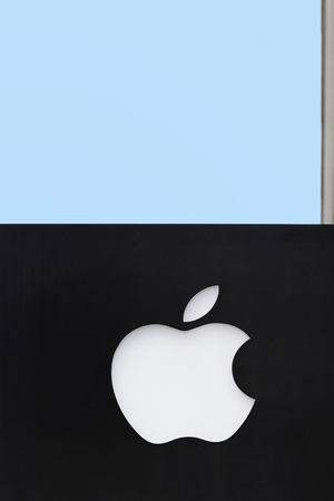 Herning, Denmark - April 9, 2016: Apple logo on a wall. Apple is an American multinational technology company that designs, develops, sells consumer electronics, computer software and online services