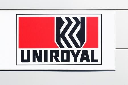 manufacturer: Macon, France - June 20, 2017: Uniroyal logo on a wall. Uniroyal is an American manufacturer of tires and other synthetic rubber-related products Editorial