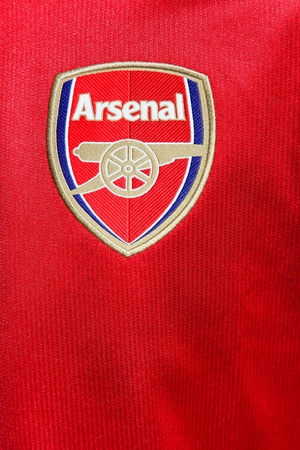 Odder, Denmark - August 8, 2017: Logo of Arsenal Football Club on a red Jersey. Arsenal Football Club is a professional football club based in London, England, that plays in the Premier League