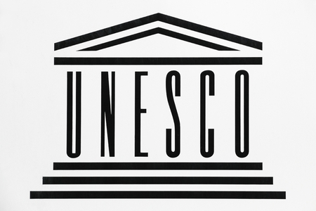 Geneva, Switzerland - October 1, 2017: UNESCO logo on a wall. UNESCO, the United Nations Educational, Scientific and Cultural Organization is a specialized agency of the United Nations based in Paris