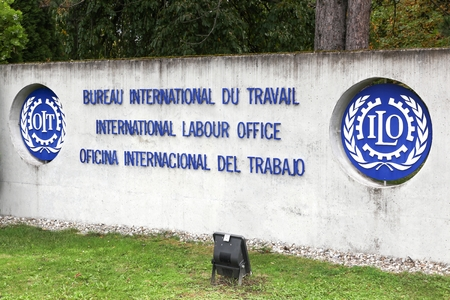 Geneva, Switzerland - October 1, 2017: International labour office logo on a wall. ILO is a United Nations specialized agency which promotes international human and labour rights Editorial