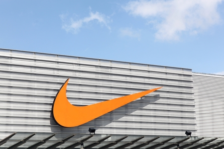Bremen, Germany - July 2, 2017: Nike logo on a facade of a store. Nike is an American company specializing in sports equipment based in Beaverton, Oregon, USA Editorial
