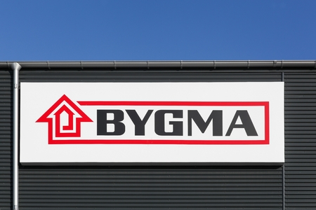Aalborg, Denmark - July 13, 2017: Bygma logo on a wall. Bygma is the largest Danish owned supplier of building materials in the Danish market Editorial