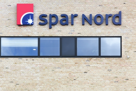 Aalborg, Denmark - July 13, 2017: Spar Nord logo on a wall. Spar Nord is a bank based in North Jutland, Denmark