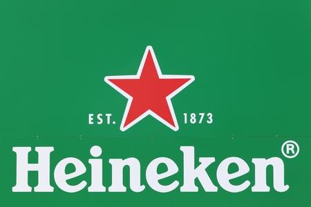 Himmerland, Denmark - August 23, 2017: Heineken logo on a wall. Heineken is a Dutch brewing company, founded in 1864 by Gerard Adriaan Heineken in Amsterdam