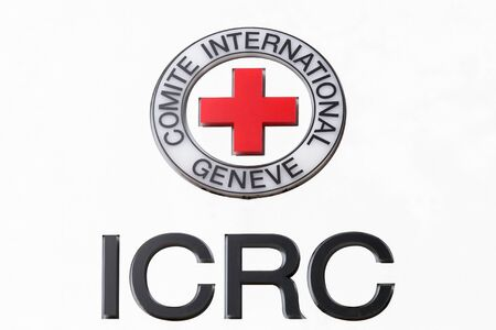 Geneva, Switzerland - October 1, 2017: ICRC logo on a panel. The International committee of the red cross also called ICRC is a humanitarian institution based in Geneva, Switzerland