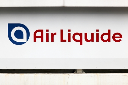 Sassenage, France - June 24, 2017: Air Liquide logo on a wall. Air Liquide is a french multinational company which supplies industrial gases and services to various industries Éditoriale