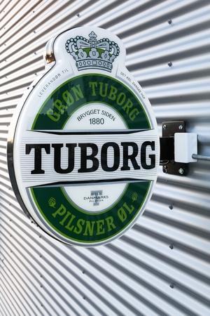 Risskov, Denmark - November 25, 2017: Tuborg beer logo on a wall. Tuborg is a Danish brewing company founded in 1873 on a harbour in Hellerup, Denmark. Tuborg is a part of Carlsberg group