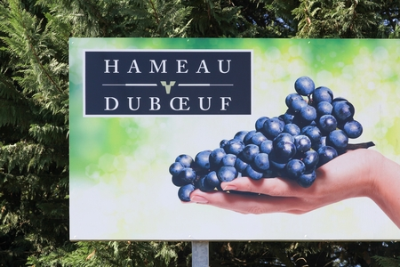 Romaneche, France - October 5, 2017: Billboard of the Museum Hameau du vin from Georges Duboeuf in Beaujolais, France