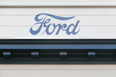 Aarhus, Denmark - August 28, 2017: Vintage Ford logo on a wall. Ford is an American multinational automaker headquartered in Dearborn, Michigan, USA Editorial