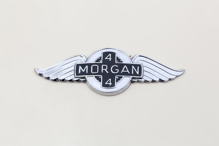 Dax, France - June 4, 2017: Morgan 4 logo on a car. The Morgan Plus 4 is an automobile produced by the Morgan motor company from 1950 to 1969 Editorial
