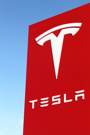 Tilst, Denmark - February 14, 2016: Tesla logo on a wall. Tesla is an American automotive and energy storage company that designs, manufactures, and sells luxury electric cars