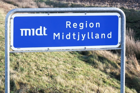 Central Denmark region called Midyjylland in danish road sign in Denmark Фото со стока